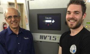John Abdnour, Nautel Regional Sales Manager, with Jay Antoney, Fresh 92.7 Volunteer Engineer, during the NV7.5lt install.